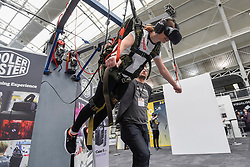 © Licensed to London News Pictures. 20/04/2017. London, UK. A user experiences the latest advancements in virtual reality through an immersive skydiving simulation at the Virtual Reality Show which opened today at the Business Design Centre in Islington.   Photo credit : Stephen Chung/LNP