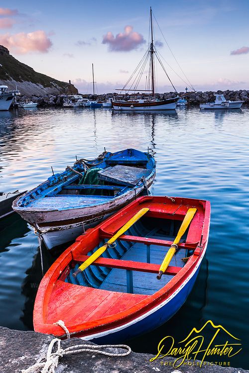 Red Boat at sunrise in Procida Italy