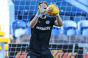 Forest Green Rovers goalkeeper Lewis Ward(34) warming up during the EFL Sky Bet League 2 match between Mansfield Town and Forest Green Rovers at the One Call Stadium, Mansfield, England on 23 February 2019.
