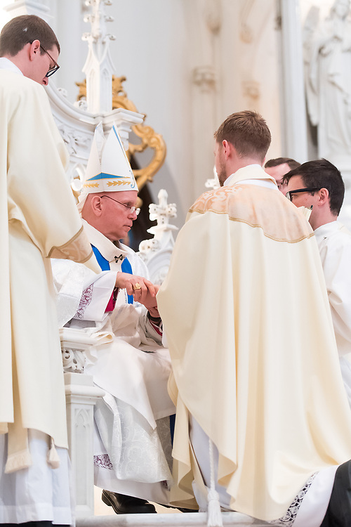 DENVER, CO - MAY 13: Denver Archbishop Samuel Aquila anoints the hands of Daniel Ciucci with Sacred Chrism during his ordination to the priesthood at the Cathedral Basilica of the Immaculate Conception on May 13, 2017, in Denver, Colorado. (Photo by Daniel Petty/for Denver Catholic)