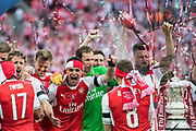 Arsenal midfielder Alex Iwobi (17), Arsenal goalkeeper Petr Cech (33), Arsenal forward Olivier Giroud (12) Arsenal players celebrate winning the The FA Cup Final match between Arsenal and Chelsea at Wembley Stadium, London, England on 27 May 2017. Photo by Sebastian Frej.