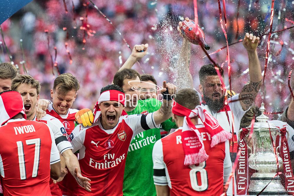 Arsenal midfielder Alex Iwobi (17), Arsenal goalkeeper Petr Cech (33), Arsenal forward Olivier Giroud (12) Arsenal players celebrate winning the The FA Cup Final match between Arsenal and Chelsea at Wembley Stadium, London, England on 27 May 2017. Photo by Sebastian Frej.
