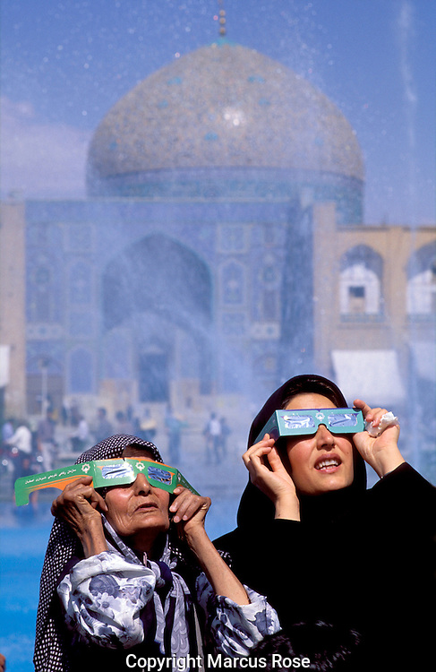 Esfahan, IRAN..Women in Imam Square looking to the skies during the solar eclipse of August 1999...