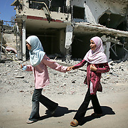 14th August 2006&amp;#xA;Aitta al Chaab, Lebanon&amp;#xA;Cease Fire in Southern Lebanon.&amp;#xA;Two young girls walk through the destroyed town of Aitta al Chaab on the 14th August 2006. The town is less than a mile from the border with Israel and has been the scene of fierce fighting in recent weeks. The ceasefire that came into play at 0800 local time allowed residents to return and survey the damage.<br />
