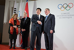 LAUSANNE, Jan. 20, 2018  International Olympic Committee (IOC) President Thomas Bach (R) shakes hands with Kim Il Guk (2nd R), the president of the Olympic Committee of the Democratic People's Republic of Korea (DPRK) in Lausanne, Switzerland, on Jan. 20, 2018. (Credit Image: © Xu Jinquan/Xinhua via ZUMA Wire)