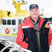 Mike Haglund, the president of the Oregon State Bar for 2013, is a maritime lawyer who represents the Columbia River Bar Pilots. The pilots, based out of Astoria, steer large ships over the treacherous Columbia bar.