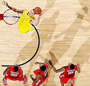 ANN ARBOR, MI - FEBRUARY 5: Mitch McGary #4 of the Michigan Wolverines dunks the ball while an audience of Ohio State Buckeyes players watch during the game at Crisler Center in Ann Arbor, Michigan on February 5. Michigan won 76-74. (Photo by Joe Robbins)