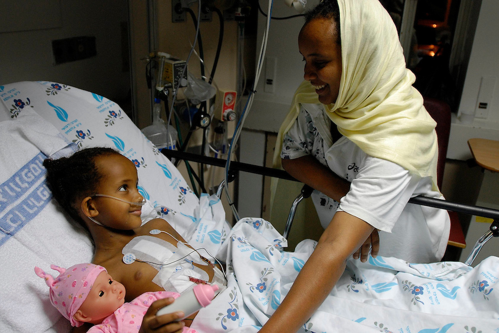 Betty And Yeshi At The Pediatric Intensive Care Unit as Betty recovers from her open-heart surgery.