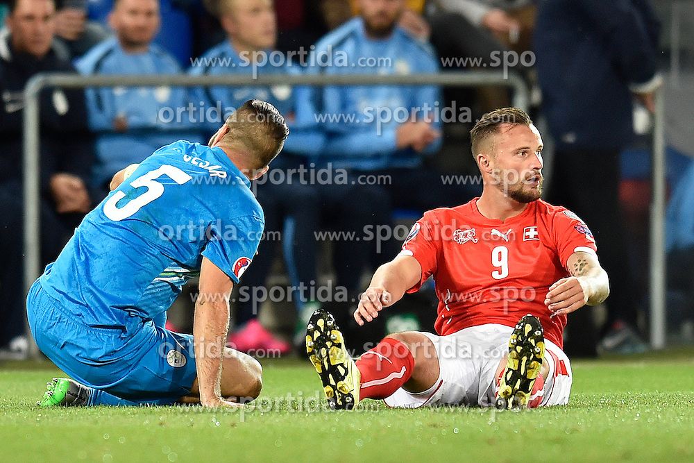05.09.2015, St. Jakob Park, Basel, SUI, UEFA Euro 2016 Qualifikation, Schweiz vs Slowenien, Gruppe E, im Bild Bostjan Cesar (SVN) und Haris Seferovic (SUI) // during the UEFA EURO 2016 qualifier group E match between Switzerland and Slovenia at the St. Jakob Park in Basel, Switzerland on 2015/09/05. EXPA Pictures &copy; 2015, PhotoCredit: EXPA/ Freshfocus/ Urs Lindt<br /> <br /> *****ATTENTION - for AUT, SLO, CRO, SRB, BIH, MAZ only*****