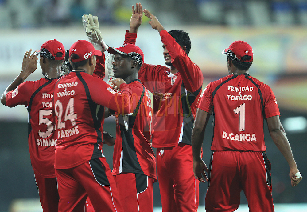 T & T team celebrates wicket of S. Smith during match 8 of the NOKIA Champions League T20 ( CLT20 )between the NSW Blues and Trinidadand Tobago held at the M. A. Chidambaram Stadium in Chennai , Tamil Nadu, India on the 28th September 2011Photo by Prashant Bhoot/BCCI/SPORTZPICS