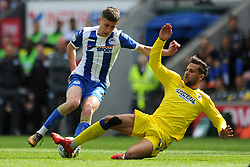Harry Forrester of AFC Wimbledon makes a challenge on Ryan Colclough of Wigan Athletic - Mandatory by-line: Greig Bertram/JMP - 28/04/2018 - FOOTBALL - DW Stadium - Wigan, England - Wigan Athletic v AFC Wimbledon -