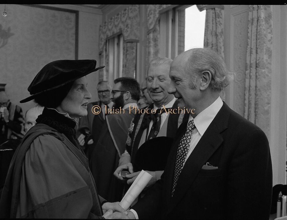Honorary Degree For Joan Denise Moriarty.    (M65)..1979..05.04.1979..04.05.1979..5th April 1979..Joan Denise Moriarty, was an Irish ballet dancer, choreographer, teacher of ballet, and traditional Irish dancer and musician. She was the founder of professional ballet in Ireland. Her achievements were rewarded by the conferring of an honorary degree at University College ,Cork...Picture shows Joan Denise Moriarty being congratulated by An Taoiseach,Mr Jack Lynch TD, on her Honorary Degree, also in the photograph is Mr Tadhg O Ciardha MA,PHD,Pro-Vice-Chancellor, University College Cork.