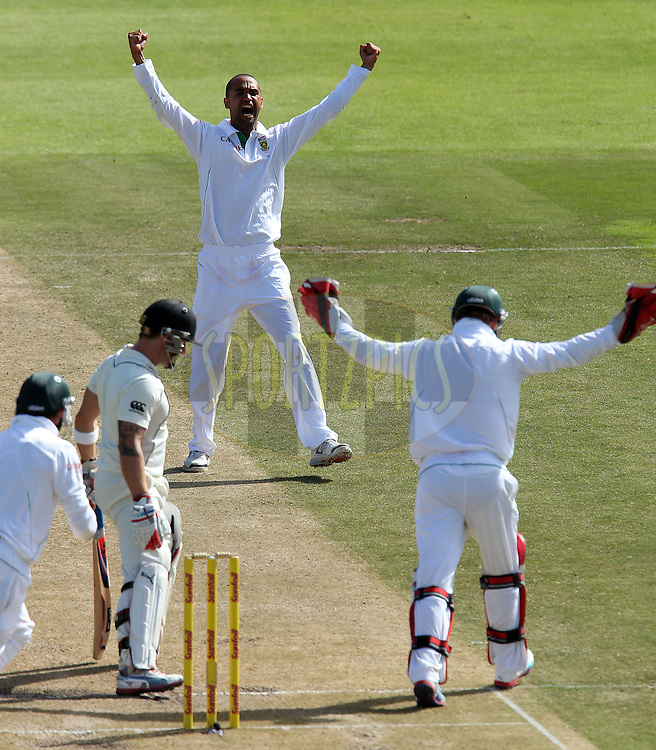 Robin Pietersen celebrates the wicket of Brendon McCullum during the 2nd day of the 1st Sunfoil Test match between South Africa and New Zealand held at Newlands Stadium in Cape Town, South Africa on the 3rd January 2013..Photo by Ron Gaunt/SPORTZPICS .