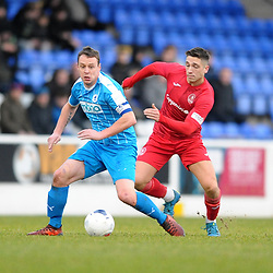TELFORD COPYRIGHT MIKE SHERIDAN Adam Walker of Telford battles for the ball with Gary Roberts during the Vanarama Conference North fixture between AFC Telford United and Chester at the 1885 Arena Deva Stadium on Saturday, December 21, 2019.<br /> <br /> Picture credit: Mike Sheridan/Ultrapress<br /> <br /> MS201920-035