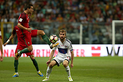August 31, 2017 - Porto, Portugal - Portugal's defender Cedric (L) vies with Faroe Islands' midfielder Roaldur Jakobsen during the 2018 FIFA World Cup qualifying football match between Portugal and Faroe Islands at the Bessa XXI stadium in Porto, Portugal on August 31, 2017. (Credit Image: © Pedro Fiuza/NurPhoto via ZUMA Press)