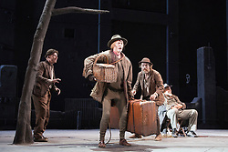 "© Licensed to London News Pictures. 05/06/2015. London, UK. L-R: Richard Roxburgh as Estragon, Luke Mulllins as Lucky, Hugo Weaving as Vladimir and Philip Quast as Pozzo. Actors Richard Roxburgh and Hugo Weaving star in Samuel Beckett's ""Waiting for Godot"" at the Barbican Theatre. Part of the International Beckett Season, this Sydney Theatre Company play is directed by Andrew Upton. With Luke Mullins as Luke, Philip Quast as Pozzo, Richard Roxburgh as Estragon and Hugo Weaving as Vladimir. Performances from 4 to 13 June 2015 at the Barbican Theatre. Photo credit : Bettina Strenske/LNP"