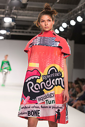 © Licensed to London News Pictures. 01/06/2014. London, England. Collection by Eujean Cha from UCA Epsom Fashion - university for the creative arts. Graduate Fashion Week 2014, Runway Show at the Old Truman Brewery in London, United Kingdom. Photo credit: Bettina Strenske/LNP
