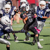 110114       Cable Hoover<br /> <br /> Cowboy Hunter Maxey (32) reaches out to grab Hawk Tommy Lujan (6) during the TDFL championship Saturday at Ford Canyon Park in Gallup.