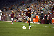 July 24th, 2012:  Colorado Rapids defender Tyrone Marshall (34) brings the ball up the pitch as Colorado Rapids gain a 2-1 victory over Swansea City AFC for a international friendly soccer match in Denver, CO.