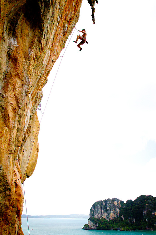 Rock climber Ross Cooper takes a lead fall over Railay Bay, Thailand.