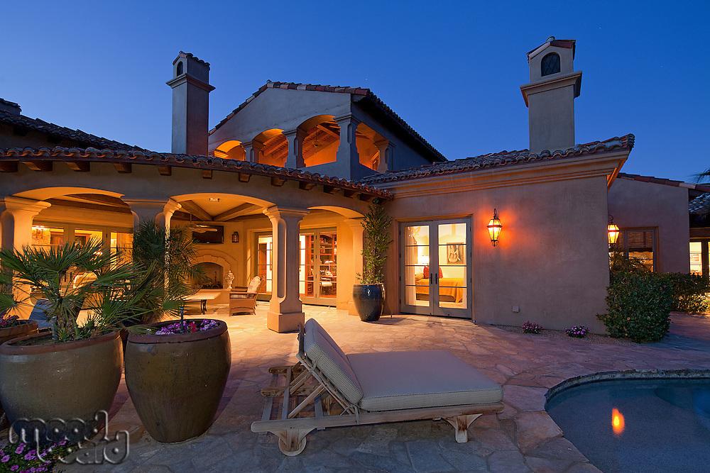 Sun lounger at poolside in luxury villa