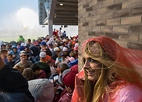 Skylar Davidson from Morton, Mississippi, takes shelter from a storm as weather delays game one of the College World Series title series at TD Ameritrade Park on Monday, June 25, 2018, in Omaha.<br /> <br /> MATT DIXON/THE WORLD-HERALD