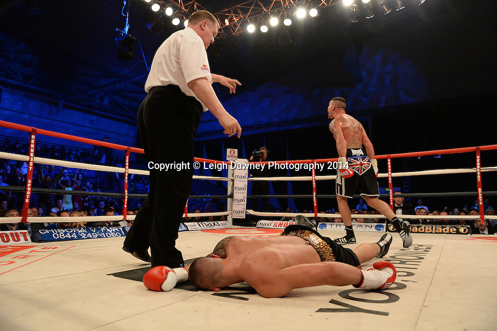 Travis Dickinson knocks out Danny McIntosh for the vacant English Light Heavyweight title at Ponds Forge Arena, Sheffield on the 22nd March 2014. Hennessy Sports. © Credit: Leigh Dawney Photography 2014.