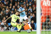 Manchester City midfielder Raheem Sterling (7) skips past Dinamo Zagreb defender Petar Stojanovic (30) during the Champions League match between Manchester City and Dinamo Zagreb at the Etihad Stadium, Manchester, England on 1 October 2019.