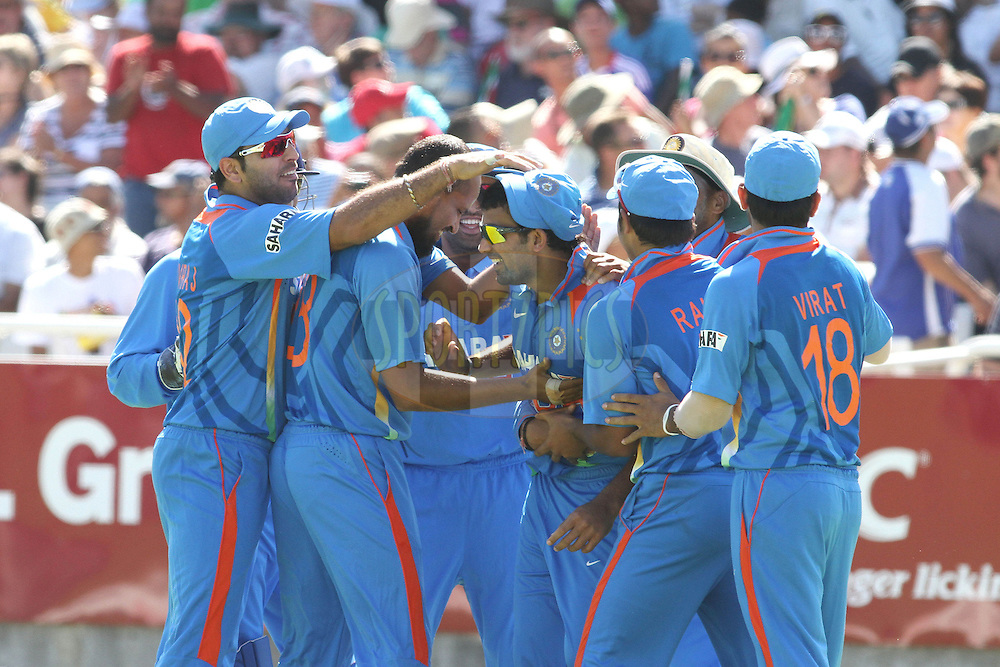 Indian players congratulate Zaheer Khan of India on taking a catch in the deep to dismiss AB de Villiers of South Africa during the 3nd ODI between South Africa and India held at Sahara Park Newlands Stadium in Cape Town, Western Cape, South Africa on the 18th January 2011..Photo by Shaun Roy/BCCI/Sportzpics
