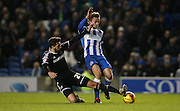 Brighton striker (on loan from Manchester United), James Wilson (21) shoots under pressure from Brentford defender Yoann Barbet during the Sky Bet Championship match between Brighton and Hove Albion and Brentford at the American Express Community Stadium, Brighton and Hove, England on 5 February 2016.