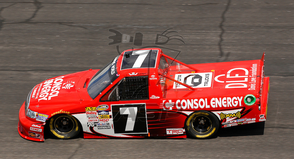 ROCKINGHAM, NC - APR 13, 2012:  John King (7) brings his truck through the turns during a practice session for the Inaugural Good Sam Roadside Assistance 200 at the Rockingham Speedway in Rockingham, NC.
