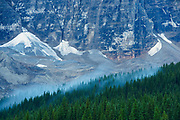 Fog lifting off Mt. Tuzo at Moraine Lake in the Valley of the Ten Peaks.<br />