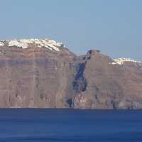 At first glance they look like ice or snow atop a mountain...but those are actually the whitewashed buildings of Santorini that face the caldera for the best views on the island.
