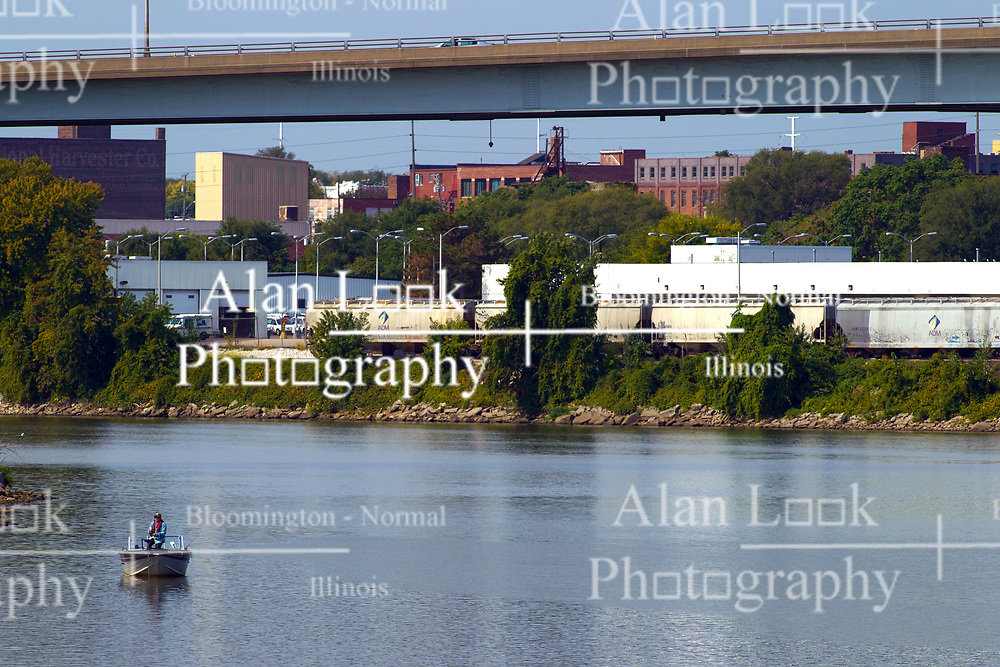 Fisherman on Illinois River near the East Peoria bank from a small boat