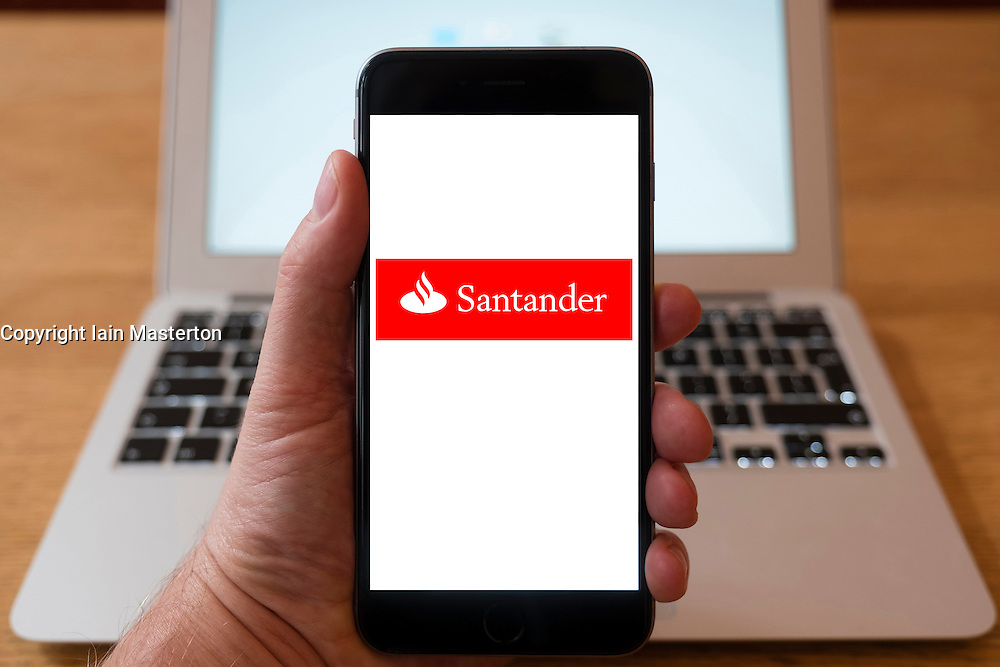 Using iPhone smartphone to display logo of Santander Bank