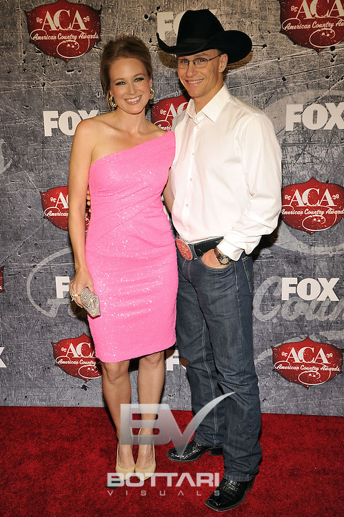 From left, Singer Jewel and Rodeo Cowboy Ty Murray arrives at the American Country Awards on Monday, Dec. 10, 2012, in Las Vegas. (Photo by Jeff Bottari/Invision/AP)