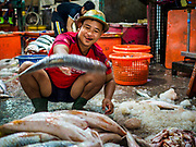 23 NOVEMBER 2017 - YANGON, MYANMAR: Sorting fish in the San Pya Fish Market. San Pya Fish Market is one of the largest fish markets in Yangon. It's a 24 hour market, but busiest early in the morning. Most of the fish in the market is wild caught but aquaculture is expanding in Myanmar and more farmed fresh water fish is being sold now than in the past.    PHOTO BY JACK KURTZ