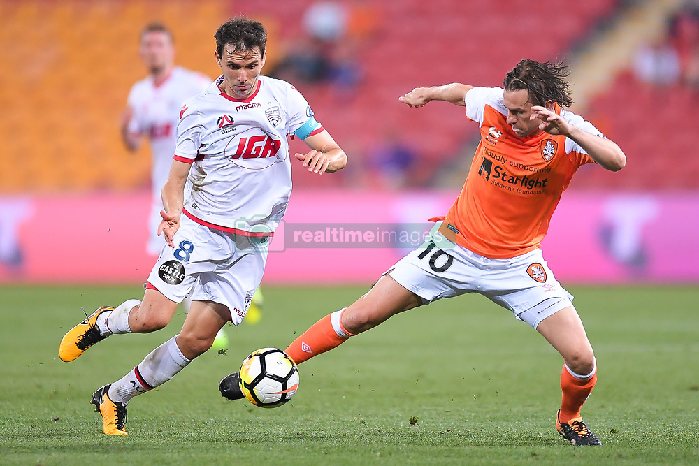 October 13, 2017 - Brisbane, Queensland, Australia - Isaias of Adelaide (#8, left) and Brett Holman of the Roar (#10) compete for the ball during the round two A-League match between the Brisbane Roar and Adelaide United at Suncorp Stadium on October 13, 2017 in Brisbane, Australia. (Credit Image: © Albert Perez via ZUMA Wire)