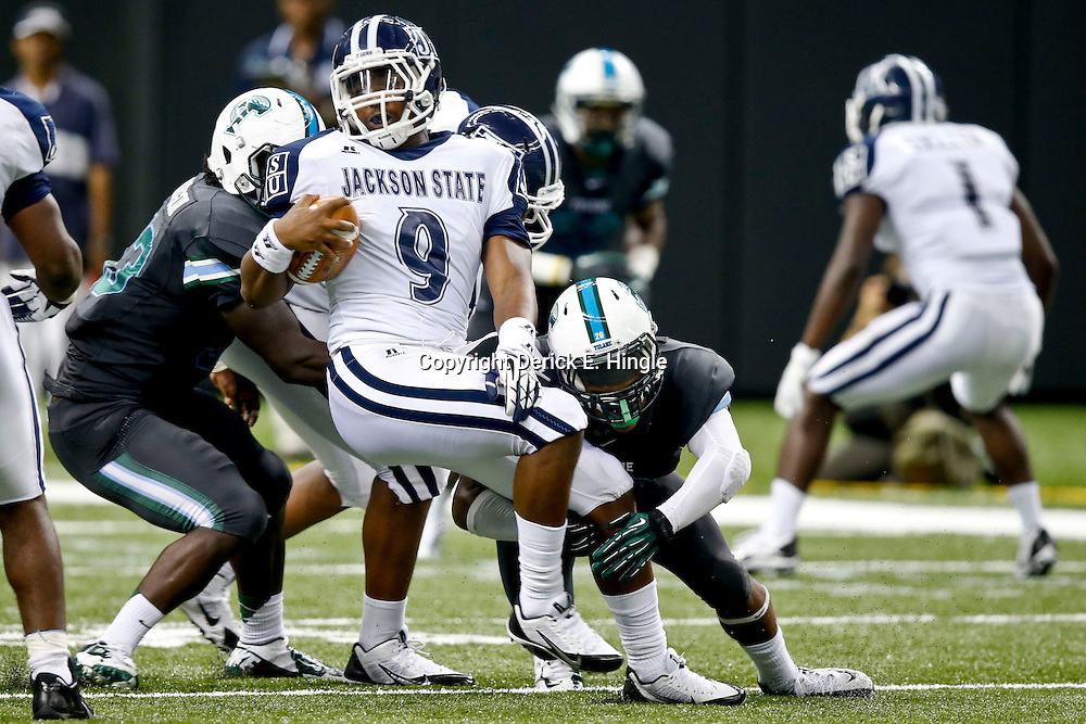 Aug 29, 2013; New Orleans, LA, USA; Jackson State Tigers quarterback LaMontiez Ivy (9) is tackled by Tulane Green Wave defenders during the first half of a game at the Mercedes-Benz Superdome. Mandatory Credit: Derick E. Hingle-USA TODAY Sports