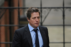 © London News Pictures. 21/11/2011. London, UK.   Hugh Grant arriving at The Royal Courts of Justice today (21/11/2011) to give evidence at the Leveson Inquiry into press standards. The inquiry is being lead by Lord Justice Leveson and is looking into the culture, and practice of the UK press. The Leveson inquiry, which may take a year or more to complete, comes after The News of The World Newspaper was closed following a phone hacking scandal. Photo credit : Ben Cawthra/LNP