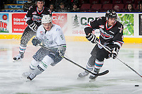 KELOWNA, CANADA - NOVEMBER 25: Scott Eansor #8 of Seattle Thunderbirds checks Tanner Wishnowski #9 of Kelowna Rockets during second period on November 25, 2015 at Prospera Place in Kelowna, British Columbia, Canada.  (Photo by Marissa Baecker/Getty Images)  *** Local Caption *** Scott Eansor; Tanner Wishnowski;