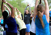 "Bob Harper, trainer on ""The Biggest Loser,"" stretches after leading a body-blasting class at SELF magazine's 21st annual Workout in the Park, Saturday, May 10, 2014, in New York's Central Park. (Photo by Diane Bondareff/Invision for SELF/AP Images)"