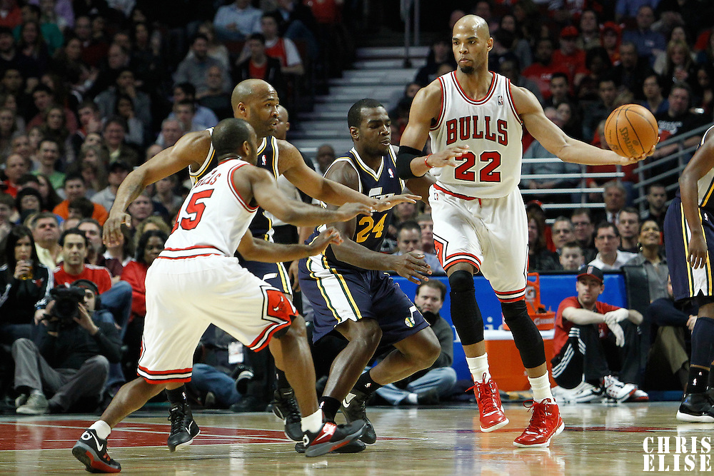 10 March 2012: Chicago Bulls forward Taj Gibson (22) passes the ball to Chicago Bulls point guard John Lucas (15) during the Chicago Bulls 111-97 victory over the Utah Jazz at the United Center, Chicago, Illinois, USA.