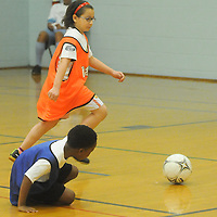 Jasara Palacil chases a loose ball during the Wilmington Hammerheads' Youth Outreach Indoor Friendly Tournament Sunday January 11, 2015 at the MLK Center in Wilmington, N.C. (Jason A. Frizzelle)