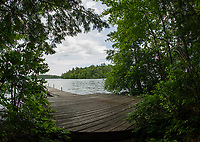 Looking out from the dock on Moon Island over to Bowman Island on Squam Lake.  Both islands are owned by Squam Lakes Association and are used by guests for camping and day visits.  (Karen Bobotas/for the Laconia Daily Sun)