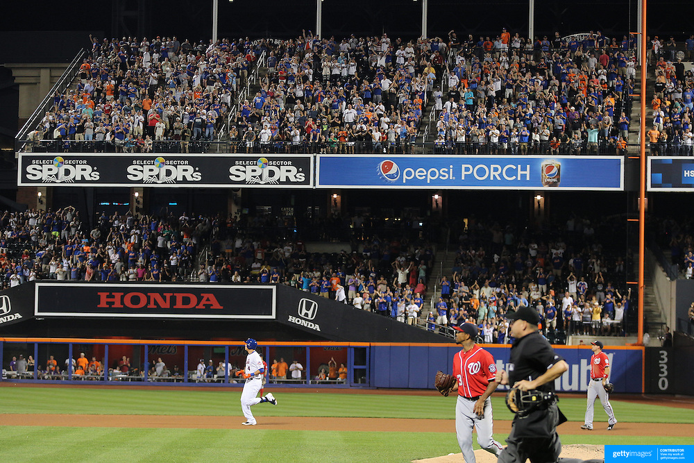 Wilmer Flores, New York Mets, heads to second base as the fans cheer as he hits a double during the New York Mets Vs Washington Nationals MLB regular season baseball game at Citi Field, Queens, New York. USA. 2nd August 2015. Photo Tim Clayton