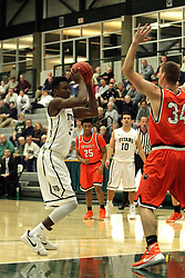 17 November 2015:  Jaylen Beasley(5) looking for a way around or over Ethan Leib during an NCAA men's division 3 CCIW basketball game between the Greenville College Panthers and the Illinois Wesleyan Titans in Shirk Center, Bloomington IL