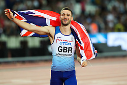 London, August 12 2017 . Daniel Talbot celebrates the gold medal won by Great Britain in the men's 4x 100m relay  on day nine of the IAAF London 2017 world Championships at the London Stadium. © Paul Davey.
