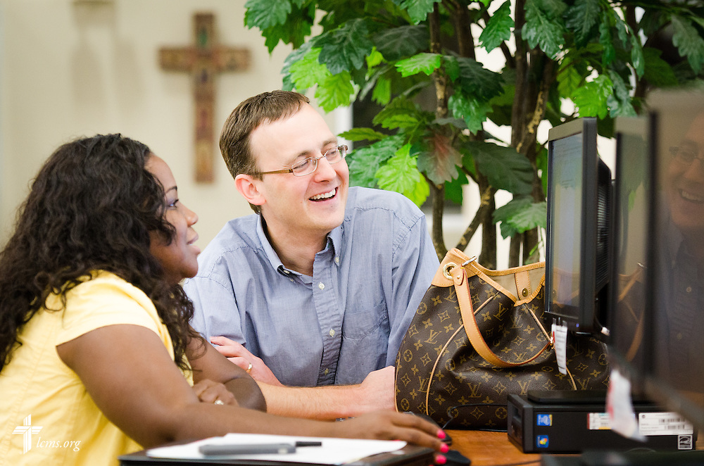 Librarian Nathan Rinne helps MBA student Yolanda Pierson in the Library Technology Center at Concordia University, Saint Paul, on Wednesday, August 6, 2014, in St. Paul, Minn.   LCMS Communications/Erik M. Lunsford