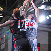 Delaware 87ers Forward Drew Gordon (32) drives towards the basket as Sioux Falls Skyforce Forward Fuquan Edwin (17) defends in the second half of a NBA D-league regular season basketball game between the Delaware 87ers and the Sioux Falls Skyforce (Miami Heat) Tuesday, Jan. 27, 2015 at The Bob Carpenter Sports Convocation Center in Newark, DEL